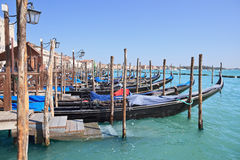 Pier with gondolas, Venice - Italy Royalty Free Stock Photos