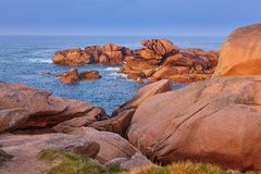 Scenic view of pink granite coast at sunset. In Brittany, France Royalty Free Stock Photography