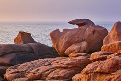 Scenic view of pink granite coast at sunset. In Brittany, France Stock Images