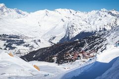 Scenic view of the popular ski resort Les Arcs in French Alps. Beautiful sunny day with blue sky. And snowy mountains stock photo