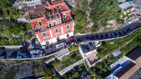 Scenic view of Positano, beautiful Mediterranean village on Amalfi, Italy narrow road and high traffic in the mountains, built royalty free stock image
