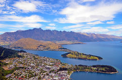 Scenic view of Queenstown and surrounding rugged mountain range The Remarkables Stock Images