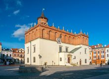 Scenic view of renaissance town hall on market square of old town in Tarnow, Poland. At sunny day Stock Photos