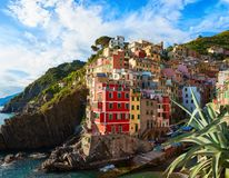 Scenic view of Riomaggiore with its colorful houses at sunset, Cinque Terre National Park, La Spezia, Liguria, Italy royalty free stock photo