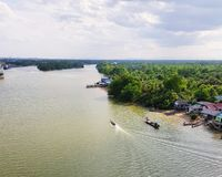 Scenic view of river against sky. Clouds, riverside, transportation, boat, rural, countryside, water, thailand, panoramic, nature, outdoor, environment stock photography