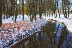 Scenic view of the river and trees with first snow. Stock Photos