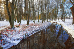 Scenic view of the river and trees with first snow. Royalty Free Stock Images
