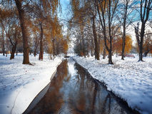 Scenic view of the river and trees with first snow Royalty Free Stock Photos