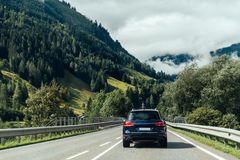 Scenic view of road crossing Alps mountains. Scenic view of road crossing Alps mountain range Stock Photo