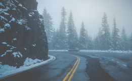 Scenic view of the road on the rock mountain with fog.  Royalty Free Stock Photography