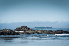 Scenic view of Ruby Beach with lighthouse royalty free stock image