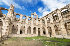 Scenic view of the ruined cloister of an abandoned monastery. Stock Photo