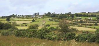 Scenic view of Rural farmhouses among farmland Stock Image