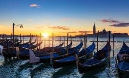 Scenic view of San Giorgio Maggiore, gondolas and lamp at colorful sunrise, Venice, Italy. Sunset in Venice. Gondolas at Saint stock image