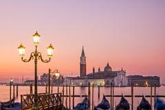 Scenic view of San Giorgio Maggiore, gondolas and lamp, Venice Stock Photo