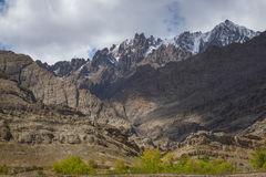 Scenic view of sand mountain with cloudy sky roadside on the way to Hemis Monastery Ladakh ,India. Stock Photo