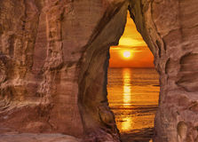 Scenic view through the sandstone arch on sunrise Royalty Free Stock Image