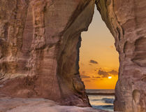 Scenic view through the sandstone arch at sunrise Royalty Free Stock Image