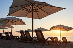 Scenic view of sandy beach with sun beds on the sea and mountains at sunset. Amara Dols Vita Luxury Hotel. Resort Stock Photography