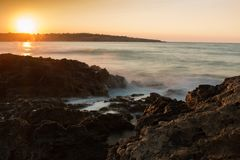 Scenic View of Sea Against Dramatic Sky during Sunset Royalty Free Stock Images