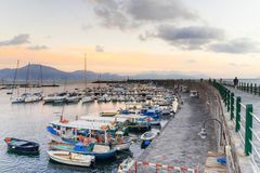 Scenic view of the sea and boats in the port at sunset, on background Sorrento peninsula in Torre del Greco near Naples. Italy Royalty Free Stock Images