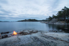 Scenic view on sea with campfire. View on Stockholm Archipelago during evening time with camp fire stock photos