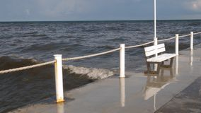 Scenic view of the sea ocean. Empty bench at the seasaide Scenic view of empty pier with white bench on it stock video
