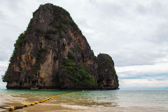 The scenic view on the sea and a rock from Phra Nang Beach. Royalty Free Stock Photo