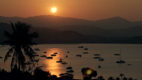 Scenic view sea yachts at parking during golden sunset in evening sky. Boat parking on background silhouettes hills and reflection sunset in sea water time stock video