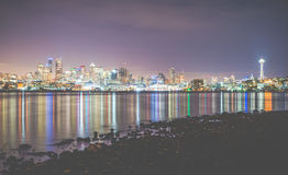 Scenic view of Seattle city in the night time with reflection in water. Royalty Free Stock Photography