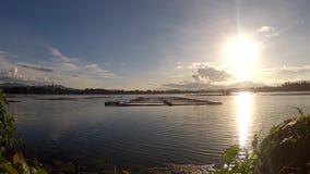 Scenic view of setting sun beneath mountain lake. Tracking shot stock video footage