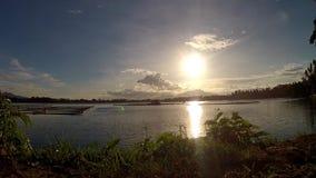 Scenic view of setting sun beneath mountain lake. Tracking shot stock video
