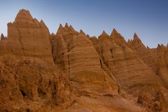 Scenic view on sharp peaks of yellow rocks against the blue sky. Himalaya mountains with weird form. Kingdom of Ladakh. India. State Jammu and Kashmir Royalty Free Stock Photo