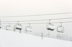 Scenic view of ski lift with  over the mountain in ski resort. Royalty Free Stock Image