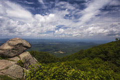 Scenic View from Skyline Drive. A scenic valley spreads out underneath a sky full of puffy clouds along Skyline Drive in Shenandoah National Park royalty free stock image