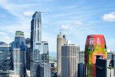 Scenic view of skyscrapers in downtown of Singapore. Amazing view of skyscrapers and other modern buildings in downtown of Singapore. The sea is visible in royalty free stock images