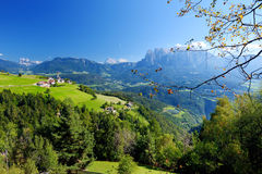 Scenic view of small Alpine village located in South Tyrol, Renon/Ritten region, Italy. Beautiful rocky mountain range on a background stock photos