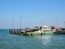Small Ferry Boat Docking at the Pier. Scenic View of Small Ferry Boat Docking at the Pier royalty free stock photography
