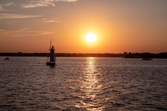 Scenic view of a small sailboat on Hudson river, New York at a sunset stock photography