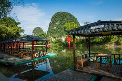 Scenic view of small tourist bamboo rafts sailing along the Yulo. Ng River among green woods and karst mountains at Yangshuo County of Guilin, China. Yangshuo is Royalty Free Stock Photography