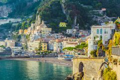 Scenic Amalfi village, Italy. Scenic view of small town Amalfi situated on coast with mountains in background. Campania region, Italy stock photo