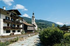 Scenic view of small village and white church in the Alps Stock Image