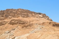 Scenic view of the snake path trail and the cable car to Masada fortress, Masada National Park, Israel. People climbing the snake path trail to Masada fortress royalty free stock photo