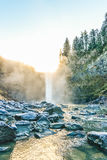 Scenic view of Snoqualmie falls with golden fog when sunrise in the morning. Royalty Free Stock Image
