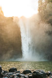 Scenic view of Snoqualmie falls with golden fog when sunrise in the morning. Royalty Free Stock Images