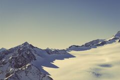 Scenic View of Snow Covered Mountains Against Sky Royalty Free Stock Photography