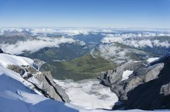 Scenic View Of Snow Covered Mountains. Snow covered mountains at swiss Stock Image