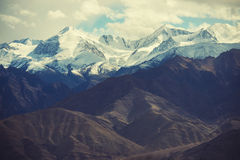 Scenic view of snow mountain mange take from Leh city , Ladakh ,India. Filter : cross processed vintage tone. Stock Photography