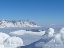 Scenic View of Snow Mountains Against Blue Sky Royalty Free Stock Photo