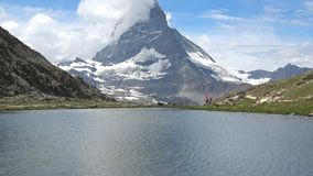 Scenic view on snowy Matterhorn peak and lake Stellisee, Zermatt, Switzerland. Scenic view on snowy Matterhorn peak and lake Stellisee, Swiss Alps, Zermatt stock video